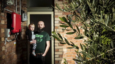 Rob Hoffman and his son, Harry, pose for a photo outside their Coburg home.