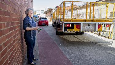 A truck backs up along an easement adjoining Karen Paxton's small business in Fyshwick. The valuation on her block went up 300% in 2016-17, affecting her business.