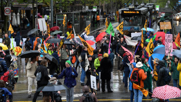 Activists from Extinction Rebellion block an intersection in Melbourne on Tuesday.