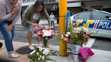 Watkins said the Christchurch shooter used 8Chan. Pictured: people leave flowers in memory of the shooter's victims in Christchurch.