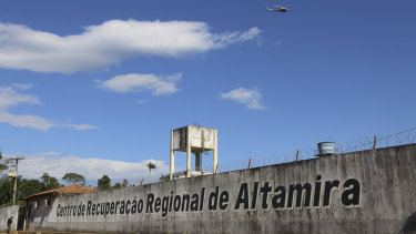 A police helicopter flies over the Regional Recovery Centre, a prison in Altamira, Para state, Brazil.