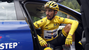 France's Julian Alaphilippe, wearing the overall leader's yellow jersey, was forced to stop riding due to a hailstorm.