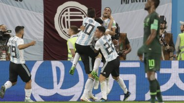 Doing just enough: Argentina players celebrate Marcos Rojo's goal.