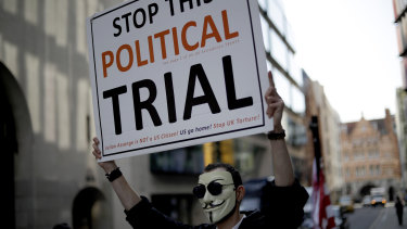 A supporter of WikiLeaks founder Julian Assange takes part in a protest outside the Central Criminal Court, the Old Bailey, in London.