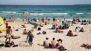 People enjoying Bondi on a hot Sunday afternoon in March. It was the sixth-hottest March on record for NSW.