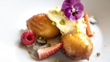 Golden puffs of ricotta served warm with spiced honey and vanilla mascarpone whip and ground pistachio from Ottoman.