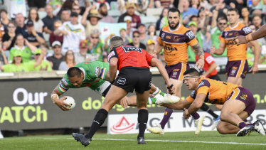 Outta my way: Joey Leilua muscles his way over for a Raiders try.