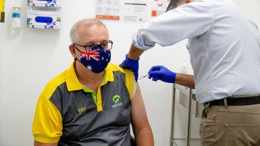 Prime Minister Scott Morrison receiving his second Pfizer jab on Sunday.
