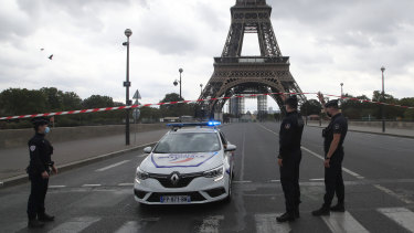 French police officers secure the bridge leading to the Eiffel Tower after a phone-in bomb threat.