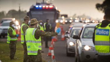 ADF personnel assist Victoria Police at a roadside checkpoint on the Geelong Freeway.