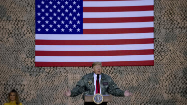 Trump flies the American flag in Iraq as he addresses the troops.