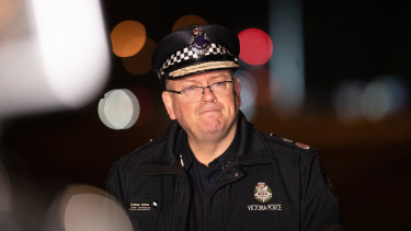 Chief commissioner Graham Ashton speaks to the media at the scene of a crash that killed four police officers.