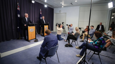 Prime Minister Scott Morrison and Chief Medical Officer Professor Brendan Murphy address the media during a press conference at Parliament House in Canberra on Sunday evening.