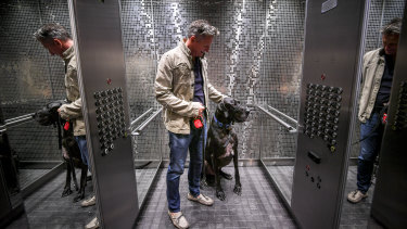 Care for a walk? Wallace the Great Dane, with his owner Stephen Edwards, is a familiar sight in his Docklands apartment tower lift.