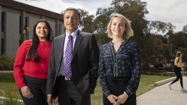 University of Canberra law and public relations student Prishika Jinna, vice-chancellor Deep Saini, and politics, international relations, and communication student Alexis Claridge on campus on Monday, after the release of a review into the university's sexual harassment and assault policies.