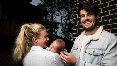 Sydney Swans midfielder George Hewett and partner Alice Summers with their son, Henry.
