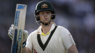 Steve Smith raises his bat as he leaves the ground after being dismissed for 82 runs.