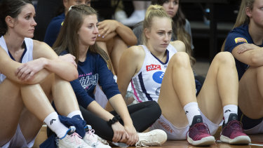 Dejected Adelaide Lightning players after losing the third WNBL grand final to the Canberra Capitals.