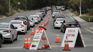 Motorists line up at a coronavirus testing site at Dodger Stadium in Los Angeles on Monday.
