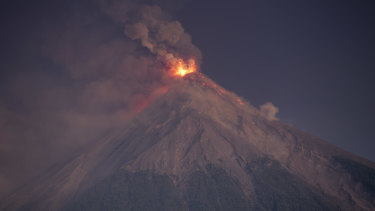 The Volcan de Fuego spews hot molten lava and ash from its crater in Escuintla, Guatemala on Monday local time.