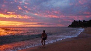 Sunrise at Newport Beach on Friday.