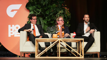 GWS football boss Wayne Campbell, inaugural coach Kevin Sheedy and director Jimmy Bartel speak at the club's grand final lunch on Wednesday.