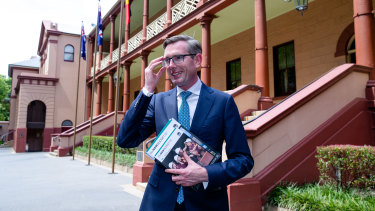 NSW Dominic Perrottet, with the freshly printed budget papers, will deliver the state's biggest deficit in a generation.