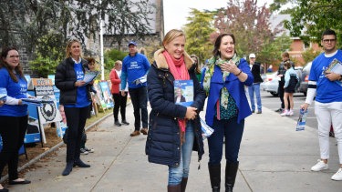 Katie Allen and Kelly O'Dwyer campaign on a pre-poll booth in Higgins on Saturday.