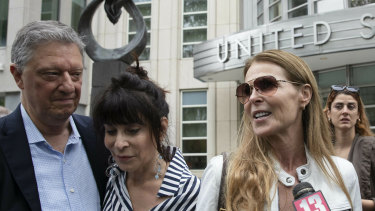 Toni Natalie, second from left, and Catherine Oxenberg talk with the media outside Brooklyn federal court after nxivm defendant Keith Raniere was found guilty on all counts in New York. Natalie is a former member and Oxenberg's daughter was a member of the group.