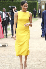 Hello, yellow ... Meghan, the Duchess of Sussex, wearing a Brandon Maxwell dress at an event in London on Thursday.