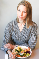 Dr Kate Gregorevic tucks into brekkie at Two Bob cafe in Melbourne's Clifton Hill.