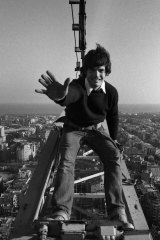 A young Mark Burry sitting atop a crane at the Sagrada Familia in 1980.