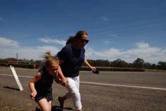 Residents flee along Putty Road in East Kurrajong.