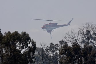Residents along Putty Road today evacuated pets and looked on while water dumping helicopters used a local dam to extract water to extinguish the fire.