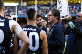 Carlton football department chief Brad Lloyd insists that Blues coach David Teague, pictured, is safe.