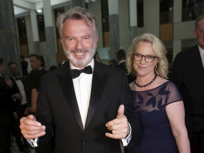 Sam Neill and Laura Tingle arrive for the Mid Winter Ball at Parliament House in  2018.