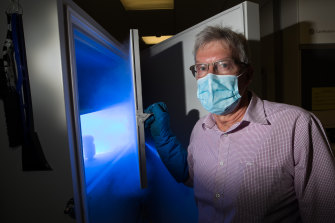 Barwon Health director of pharmacy Greg Weekes with the freezer that will contain the Pfizer vaccines.
