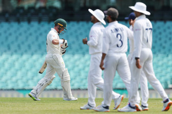 Marcus Harris departs the SCG after being dismissed.
