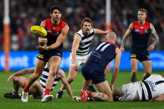 Christian Petracca gets a handpass away for the Demons.