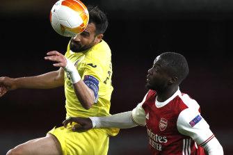 Mario Gaspar rises above Arsenal's Nicolas Pepe.