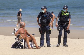 Police ask people to leave St Kilda beach on the last day of February's snap lockdown.