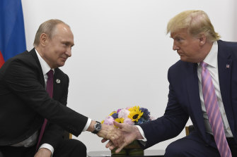 Russian President Vladimir Putin shakes hands with US President Donald Trump in 2019.