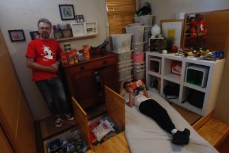 Mark Jordan in his son Bill's bedroom, where he has built a pantry cupboard into a false floor.