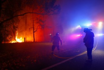 Firefighters at Gospers Mountain, one of the worst fires in the state on Tuesday.