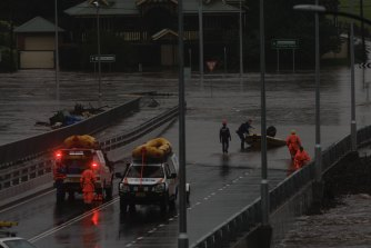 SES teams have been rescuing people trapped on rooftops that have been cut off from rising floodwaters as the Windsor bridge goes underwater.