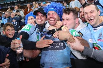 James Tedesco celebrates with fans after NSW's series victory last year.