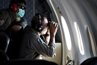 The Indonesian navy's maritime patrol aircraft search for the missing submarine.