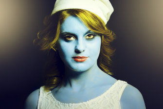 A young woman as a Smurf, the small blue species that helped to define an Australian childhood.