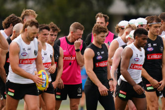 Collingwood coach Nathan Buckley (centre) with his players at training on Wednesday.