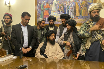 Taliban fighters take control of Afghan presidential palace in Kabul, Afghanistan.